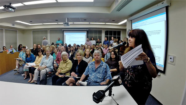 SavePacificView.org's Mary Fleener presents the Encinitas Union School District's superintendent and board with the nearly 500 Save Pacific View emails you've sent so far. An overflow crowd of Pacific View supporters packed the March 11 meeting, and those who spoke on behalf of stopping the auction and saving the property were diverse, passionate and eloquent. Trustee Maureen Muir's effort to get the board to set a new meeting date to discuss stopping the auction was abruptly squelched by the other board members, but it's too soon to know how the board will ultimately react to this tremendous community outpouring. In the meantime, getting more people to send Save Pacific View emails will keep the pressure on.