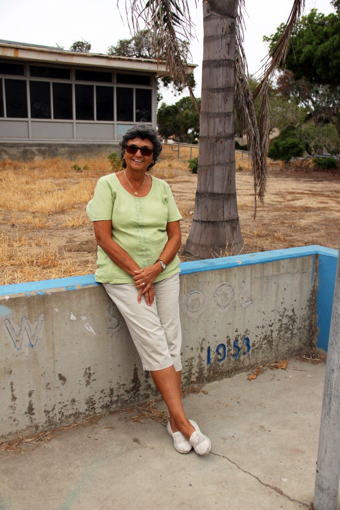 Encinitas City Councilmember rests in front of the now-dilapidated Pacific View school on June 30, 2014.