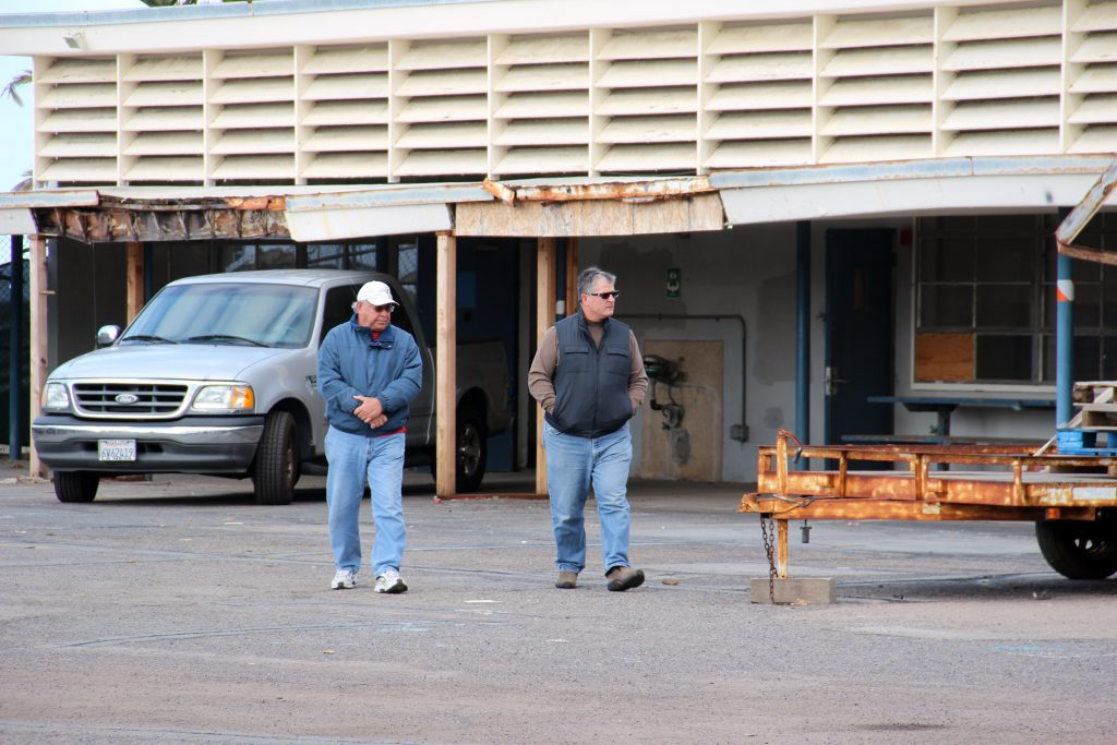 Encinitas Chamber of Commerce CEO Bob Gattinella (left) and Encinitas City Councilmember Tony Kranz inspected the city's newly acquired Pacific View property on the morning of December 30, 2014. They discussed the condition and salvageability of the buildings, and informally brainstormed uses for them.