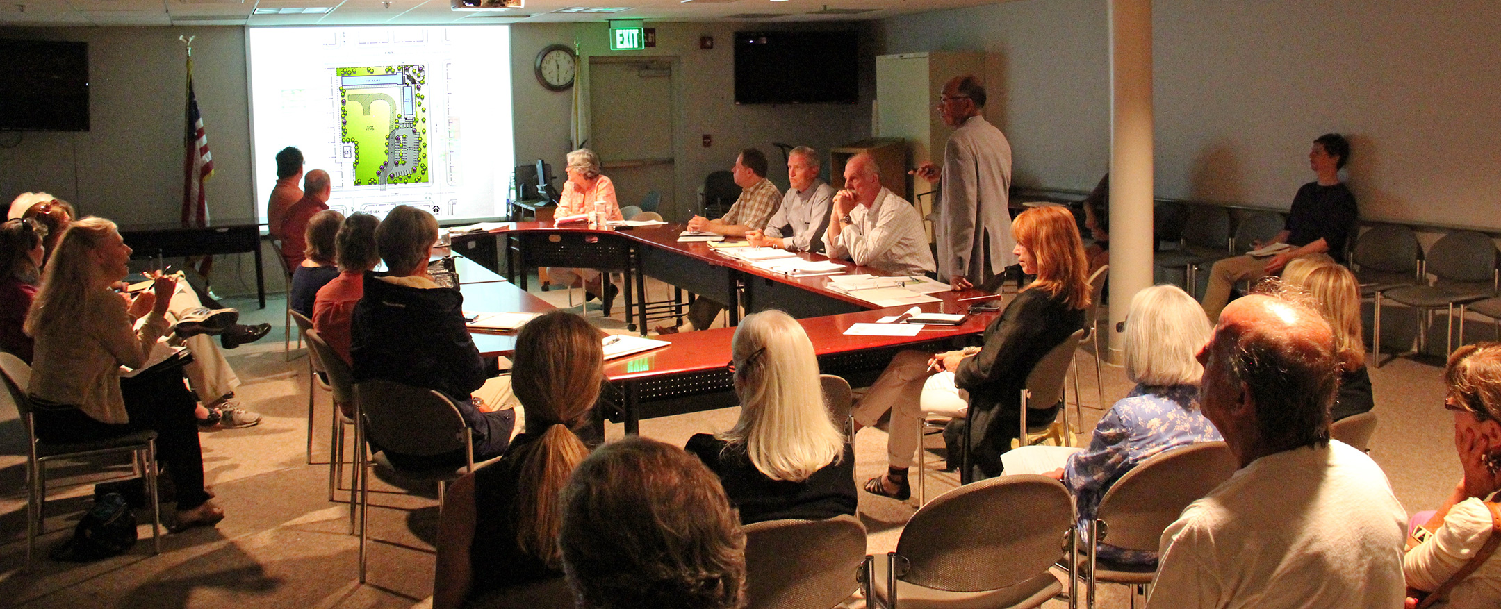 Architect Frisco White (standing, right) presents Westberg+White's preliminary architectural design report for Pacific View at the Activation Subcommittee meeting on June 29, 2015. Several ideas and changes were suggested by attendees, most of which White agreed to include in his final report.