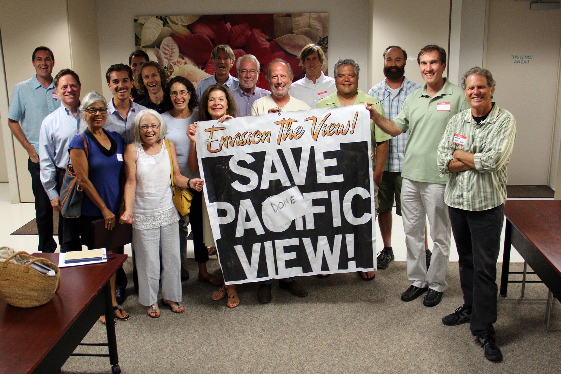 "Several Pacific View Collaboration Workshop participants gather around a banner from an earlier attempt to rescue Pacific View from development. Danny Salzhandler of the 101 Artists' Colony and the Arts Alive Foundation has triumphantly added a ""DONE"" label to the banner."