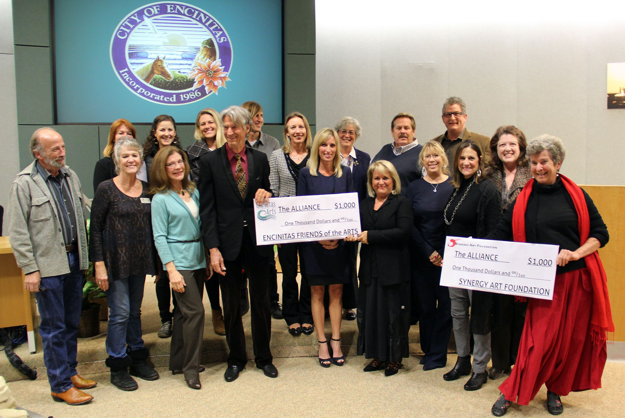 Encinitas Friends of the Arts and the Synergy Art Foundation each donated $1000 to the Encinitas Arts, Culture and Ecology Alliance as a demonstration of support for the Alliance's efforts to rehabilitate and administer the Pacific View property. Pictured at the presentation during the January 27 Encinitas City Council meeting are (front row, l. to r.) 101 Artists' Colony President Danny Salzhandler, Encinitas Historical Society President Carolyn Cope, 101 Artists' Colony Board Member Kay Colvin, Alliance President Garth Murphy, Mayor Kristin Gaspar, Encinitas Friends of the Arts President Naimeh Tanha, Friends of the Arts' Laura Diede, Friends of the Arts' Deanne Sabeck, Synergy Art Foundation's Patricia Friescher, Synergy Art Foundation's Irène de Watteville (back row, l. to r.) Encinitas 101 MainStreet Association Executive Director Thora Guthrie, musician/activist Ashley Mazanec, Alliance attorney Trisha Hilder, Alliance Vice-President Jon Humphrey, Council Member Catherine Blakespear, Deputy Mayor Lisa Shaffer, Council Member Mark Muir, and Council Member Tony Kranz.